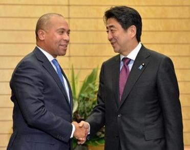 Governor Deval Patrick chatted with Japanese Prime Minister Shinzo Abe prior to talks in Tokyo on Wednesday.